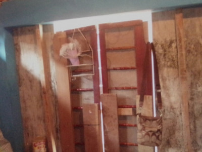 Help a family of six to buy materials to build a home